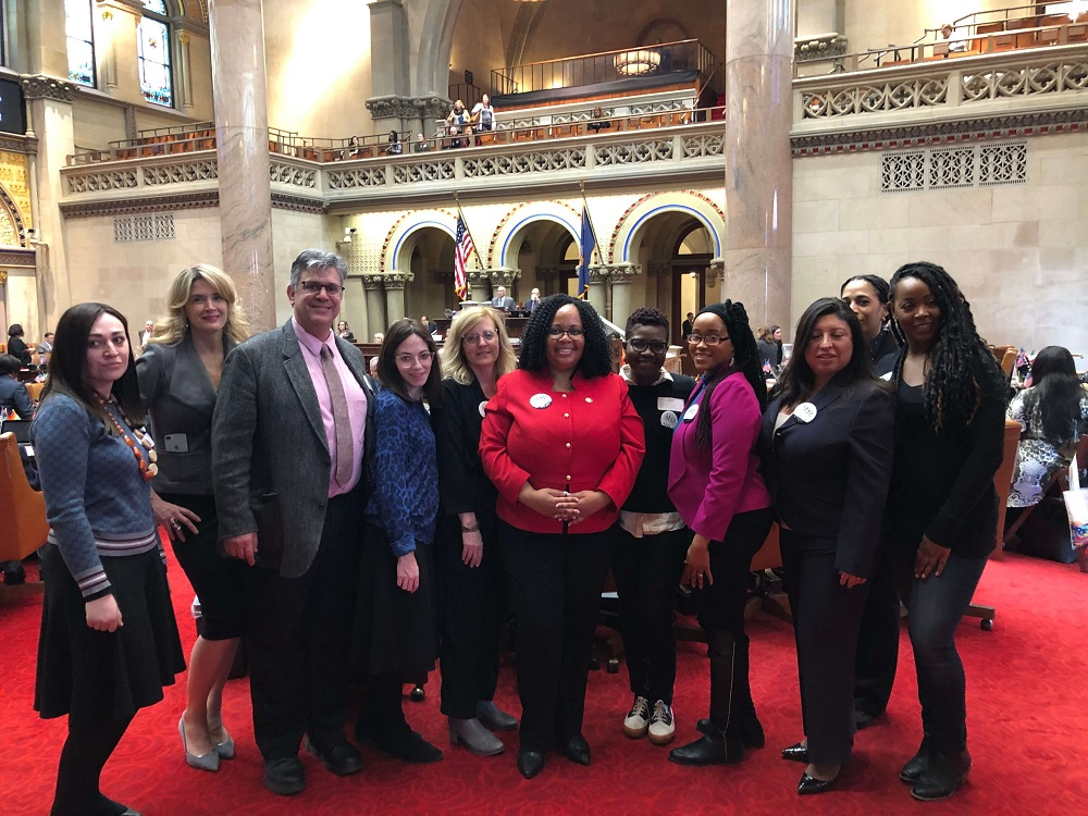 Almost two dozen GSSW students visited the state capital for the annual Social Worker Legislative Education and Advocacy Day (LEAD) held on March 3. Above, students pose for a photo with NY State Assemblywoman Mathylde Frontus.